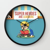 super heroes Wall Clocks featuring Super Heroes Are Learners by youngmindz