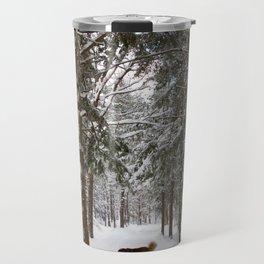 Dog exploring a snowy forest Travel Mug
