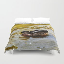 Duck swimming in golden water Duvet Cover