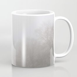 Early morning sun and trees in fog. South Pickenham, Norfolk, UK. Coffee Mug