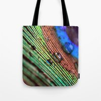 peacock feather Tote Bags featuring peacock feather by Falko Follert Art-FF77