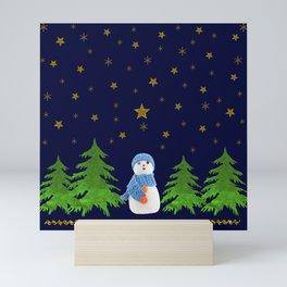 Sparkly gold stars, snowman and green tree Mini Art Print