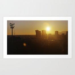 Sunset behind city skyline. Art Print