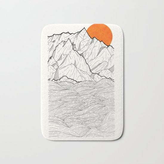 The orange sun Bath Mat