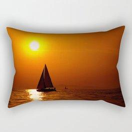 A sailboat at sunset Rectangular Pillow
