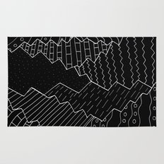 The black and white mountains Rug