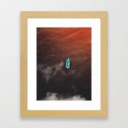 A boat on the ocean Framed Art Print