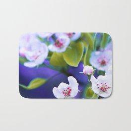 Little white flowers on Purple light Bath Mat