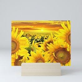 Sunflower fields with golden sky - Jéanpaul Ferro Mini Art Print