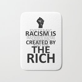 RACISM IS CREATED BY THE RICH Bath Mat
