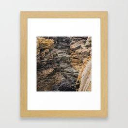 Bretagne - black rock formations between brown rock Framed Art Print