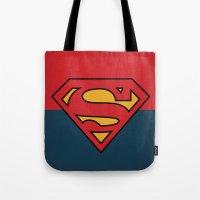 dc comics Tote Bags featuring Super Man Logo Minimalist Art Print DC Comics by The Retro Inc