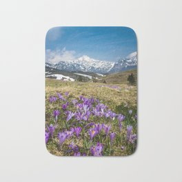 Mountains and crocus flowers on Velika Planina, Slovenia Bath Mat