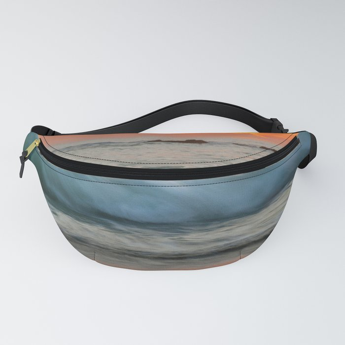 Golden sunset with turquoise waters Fanny Pack
