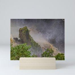 Rock showing in the waterfall Mini Art Print