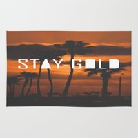 stay gold Area & Throw Rugs featuring Stay Gold by Trash Apparel