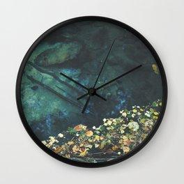 Leaf rug on water Wall Clock