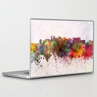 oakland Laptop & iPad Skins featuring Oakland skyline in watercolor background by Paulrommer