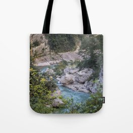 Walking by the river Tote Bag