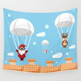 Santa Claus and reindeer parachutists delivering presents Wall Tapestry
