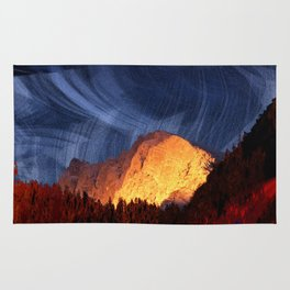 the rock at sunset Rug