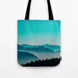 Rise above the mist. Turquoise Tote Bag
