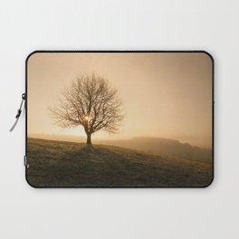 Rising sun behind a baren tree on a crisp fall or spring morning Laptop Sleeve