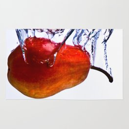 Pear falls into water with a splash on white background Rug