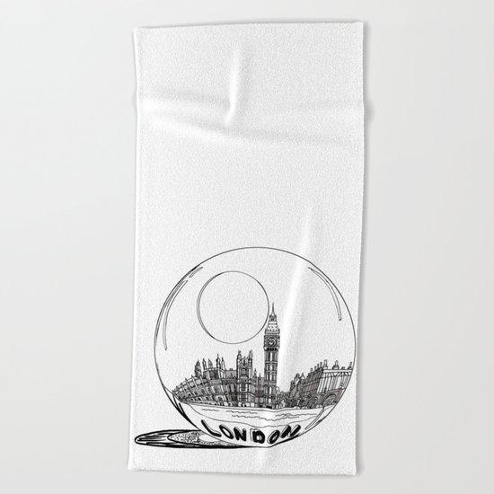 London in a glass ball Beach Towel