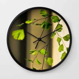 Leaflets In The Light Wall Clock