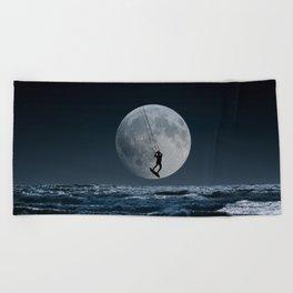 Kitesurfer in the moon in blue night sky horizon Beach Towel