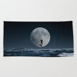 Kitesurfer in the moon in blue night sky horizon Beach Towel
