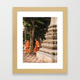 Monks in motion. Framed Art Print