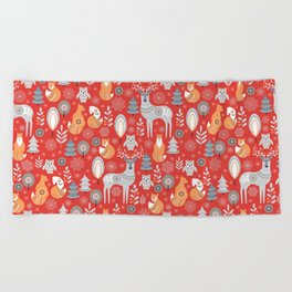 Scandinavian Christmas pattern on a red background. Deer, owls, foxes, trees and grass, snowflakes. Beach Towel