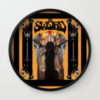 sword Wall Clocks featuring The Sword by Freddie Meagher