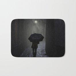 Night walk in the rain Bath Mat