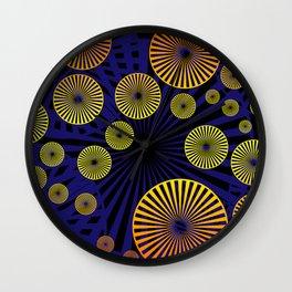Yellow orange Spiralson blue background Wall Clock