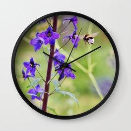 Flying bumble-bee in meadow Wall Clock