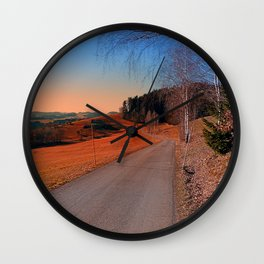 Country road into a beautiful sunset at Auberg   landscape photography Wall Clock