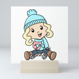 Girl Sledding On The Snow Mini Art Print