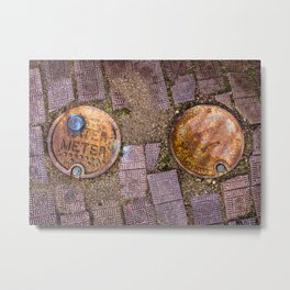 Water Meter Caps, from my street photography collection Metal Print
