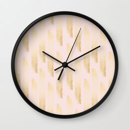 Gold strokes on a pink background. Wall Clock