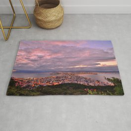 Aerial view of a magnificent city and her surroundings at twilight Rug