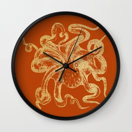 Gold octopus on burnt orange background Wall Clock