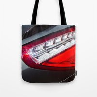mercedes Tote Bags featuring Mercedes-Benz SL 63 AMG Bi-Turbo Back Light by Mauricio Santana