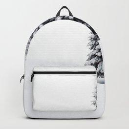 Pine tree in snow blizzard in winter scenery Backpack