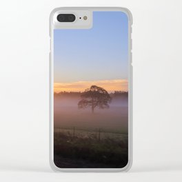SOLITARY TREE ENCASED IN FOG WITH SUN RISING Clear iPhone Case