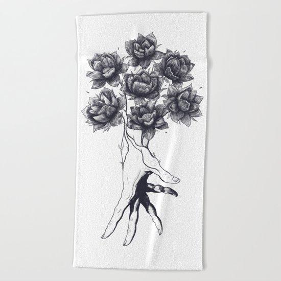 Hand with lotuses Beach Towel