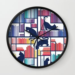 Rainbow bookshelf // white background navy blue shelf and library cats Wall Clock