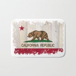 California Republic flag on woodgrain   Bath Mat